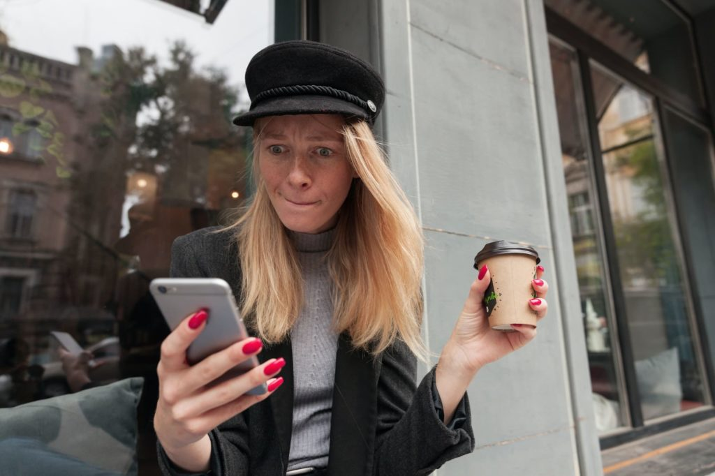 Woman reading low quality article